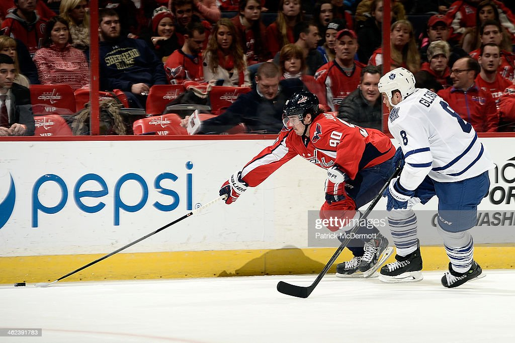 <a gi-track='captionPersonalityLinkClicked' href=/galleries/search?phrase=Marcus+Johansson&family=editorial&specificpeople=4247883 ng-click='$event.stopPropagation()'>Marcus Johansson</a> #90 of the Washington Capitals battles for the puck against <a gi-track='captionPersonalityLinkClicked' href=/galleries/search?phrase=Tim+Gleason&family=editorial&specificpeople=211575 ng-click='$event.stopPropagation()'>Tim Gleason</a> #8 of the Toronto Maple Leafs in the second period during an NHL game at Verizon Center on January 10, 2014 in Washington, DC.