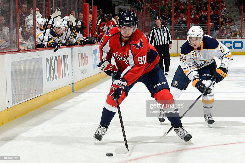 <a gi-track='captionPersonalityLinkClicked' href=/galleries/search?phrase=Marcus+Johansson&family=editorial&specificpeople=4247883 ng-click='$event.stopPropagation()'>Marcus Johansson</a> #90 of the Washington Capitals brings the puck down ice during an NHL game against the Buffalo Sabres at Verizon Center on March 17, 2013 in Washington, DC.