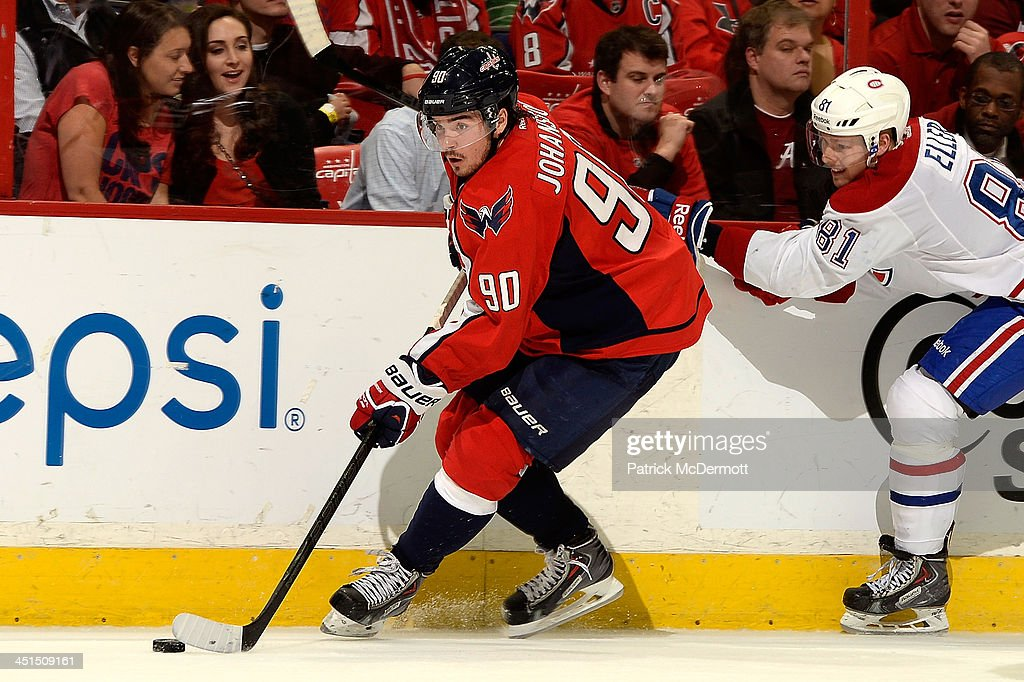 <a gi-track='captionPersonalityLinkClicked' href=/galleries/search?phrase=Marcus+Johansson&family=editorial&specificpeople=4247883 ng-click='$event.stopPropagation()'>Marcus Johansson</a> #90 of the Washington Capitals brings the puck up ice along the boards during the third period of an NHL game against the Montreal Canadiens at Verizon Center on November 22, 2013 in Washington, DC.