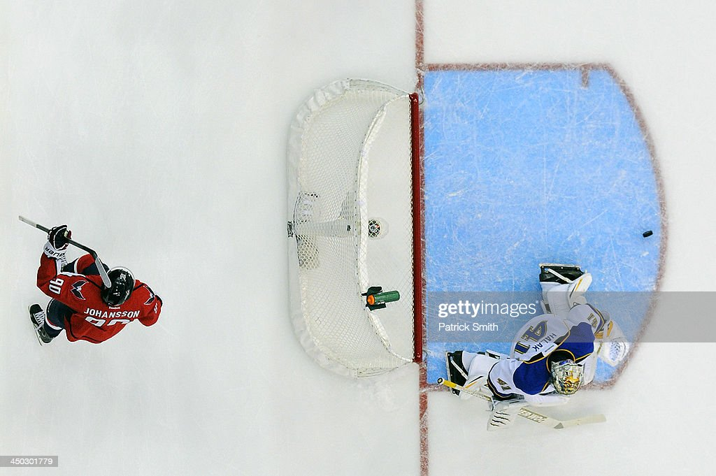 <a gi-track='captionPersonalityLinkClicked' href=/galleries/search?phrase=Marcus+Johansson&family=editorial&specificpeople=4247883 ng-click='$event.stopPropagation()'>Marcus Johansson</a> #90 of the Washington Capitals celebrates a goal by teammate Mikhail Grabovski #84 (not pictured) as goalie <a gi-track='captionPersonalityLinkClicked' href=/galleries/search?phrase=Jaroslav+Halak&family=editorial&specificpeople=2285591 ng-click='$event.stopPropagation()'>Jaroslav Halak</a> #41 of the St. Louis Blues reacts in the first period during an NHL game at the Verizon Center on November 17, 2013 in Washington, DC.