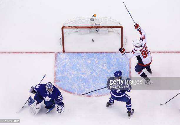 Marcus Johansson of the Washington Capitals celebrates a goal by teammate Alex Ovechkin against Frederik Andersen and Martin Marincin during the...
