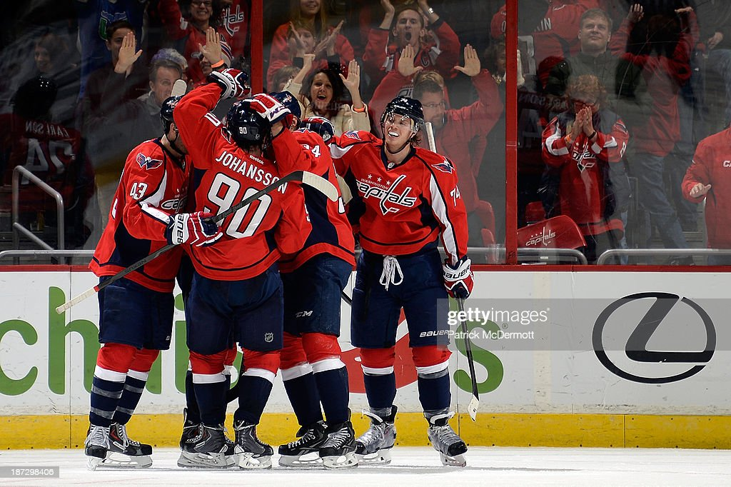 Marcus Johansson #90 of the Washington Capitals celebrates after scoring a goal in the third period during an NHL game against the Minnesota Wild at Verizon Center on November 7, 2013 in Washington, DC.