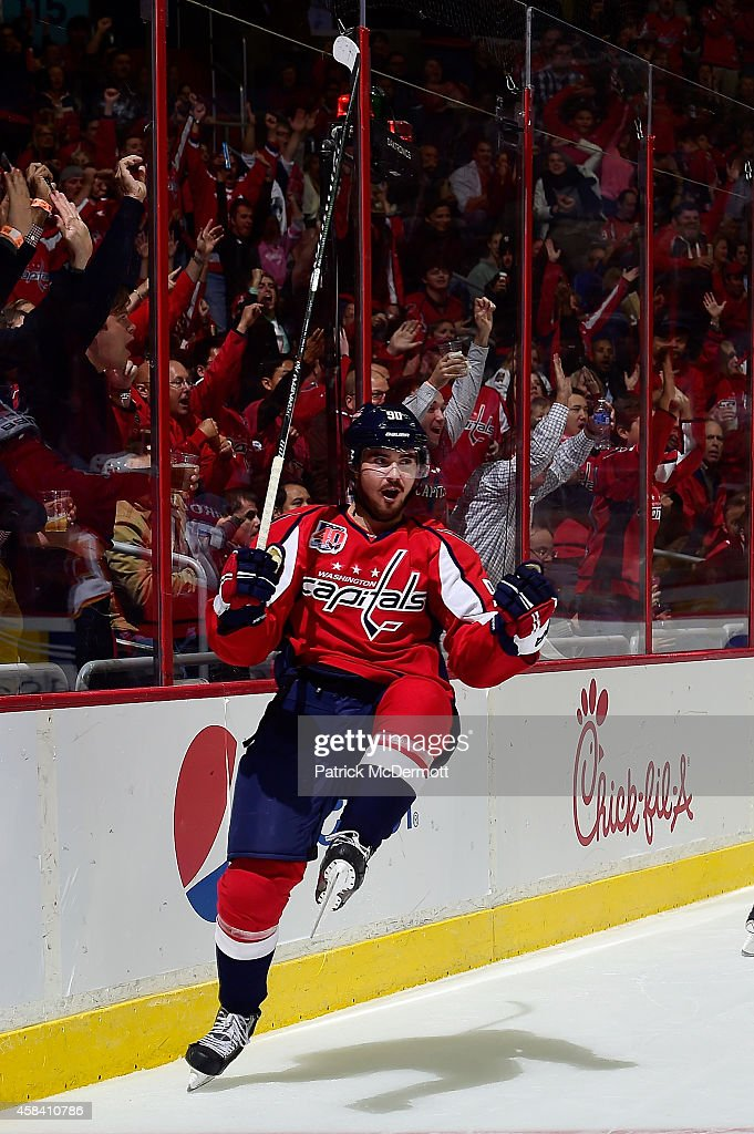 Marcus Johansson of the Washington Capitals celebrates after scoring a goal in the second period against the Calgary Flames during an NHL game at...