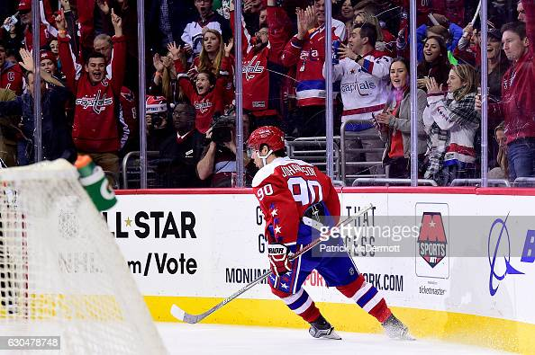 Marcus Johansson of the Washington Capitals celebrates after scoring a goal against the Tampa Bay Lightning in the third period during a NHL game at...