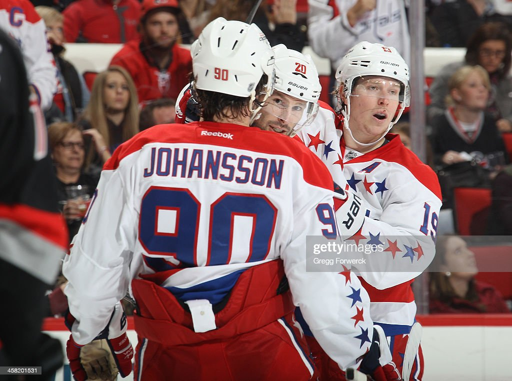 Marcus Johansson of the Washington Capitals celebrates his second period goal with teammates Troy Brouwer and Nicklas Backstrom during their NHL game...