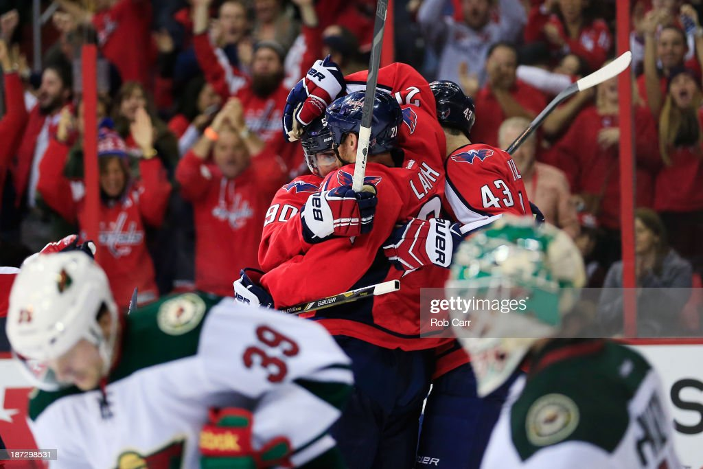 Marcus Johansson #90 of the Washington Capitals celebrates scoring a third period goal with Brooks Laich #21 during the Capitals 3-2 shootout win over the Minnesota Wild at Verizon Center on November 7, 2013 in Washington, DC.