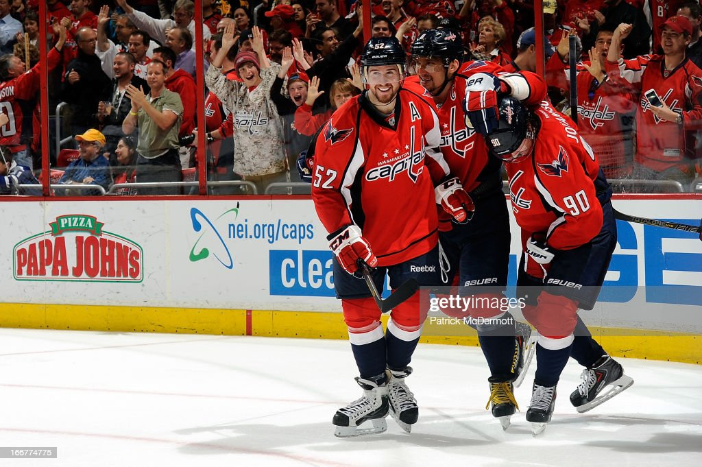 <a gi-track='captionPersonalityLinkClicked' href=/galleries/search?phrase=Marcus+Johansson&family=editorial&specificpeople=4247883 ng-click='$event.stopPropagation()'>Marcus Johansson</a> #90 of the Washington Capitals celebrates with Alex Ovechkin #8 and Mike Green #52 after scoring a goal in the third period during an NHL game against the Toronto Maple Leafs at Verizon Center on April 16, 2013 in Washington, DC.