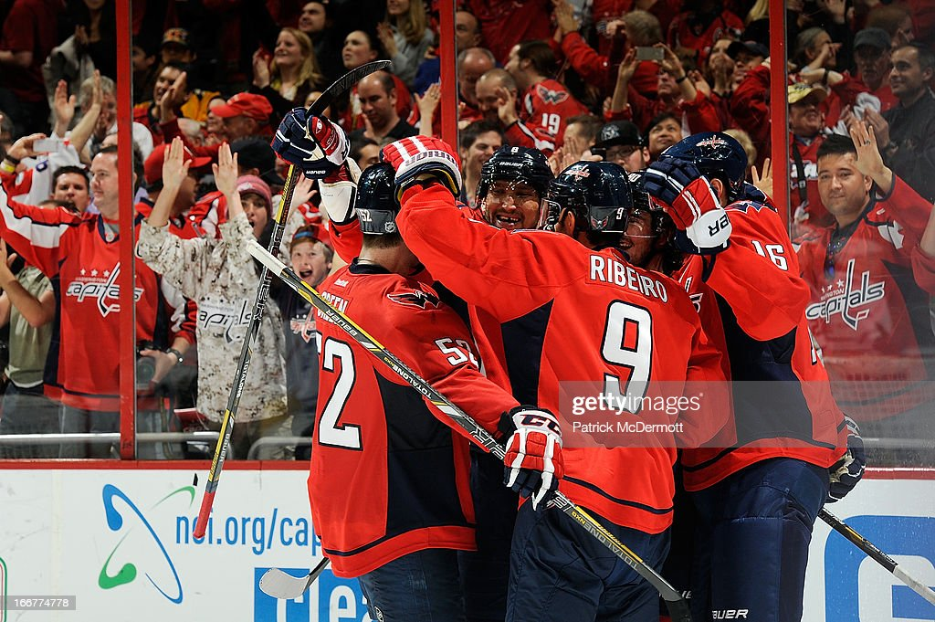 <a gi-track='captionPersonalityLinkClicked' href=/galleries/search?phrase=Marcus+Johansson&family=editorial&specificpeople=4247883 ng-click='$event.stopPropagation()'>Marcus Johansson</a> #90 of the Washington Capitals celebrates with his teammates after scoring a goal in the third period during an NHL game against the Toronto Maple Leafs at Verizon Center on April 16, 2013 in Washington, DC.