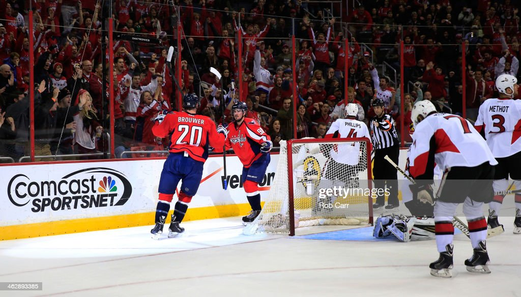 <a gi-track='captionPersonalityLinkClicked' href=/galleries/search?phrase=Marcus+Johansson&family=editorial&specificpeople=4247883 ng-click='$event.stopPropagation()'>Marcus Johansson</a> #90 of the Washington Capitals celebrates with <a gi-track='captionPersonalityLinkClicked' href=/galleries/search?phrase=Troy+Brouwer&family=editorial&specificpeople=4155305 ng-click='$event.stopPropagation()'>Troy Brouwer</a> #20 after scoring a first period goal against the Ottawa Senators at Verizon Center on November 27, 2013 in Washington, DC.