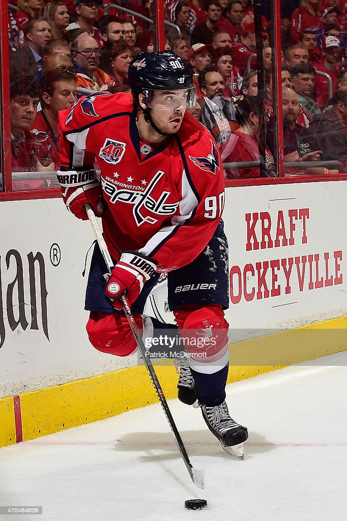 Marcus Johansson of the Washington Capitals controls the puck against the New York Islanders during the second period in Game Two of the Eastern...