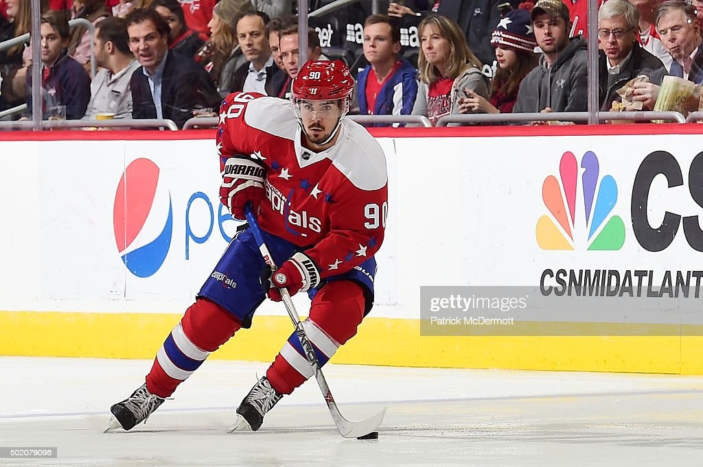 Marcus Johansson of the Washington Capitals controls the puck against the Ottawa Senators in the first period during an NHL game at Verizon Center on...