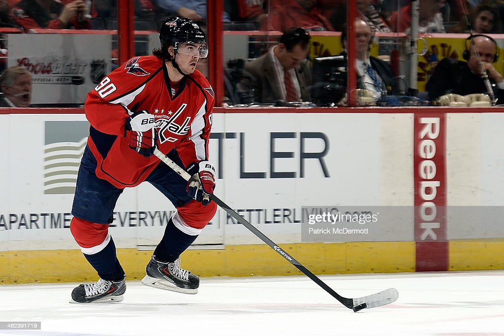 <a gi-track='captionPersonalityLinkClicked' href=/galleries/search?phrase=Marcus+Johansson&family=editorial&specificpeople=4247883 ng-click='$event.stopPropagation()'>Marcus Johansson</a> #90 of the Washington Capitals controls the puck in the first period during an NHL game against the Toronto Maple Leafs at Verizon Center on January 10, 2014 in Washington, DC.