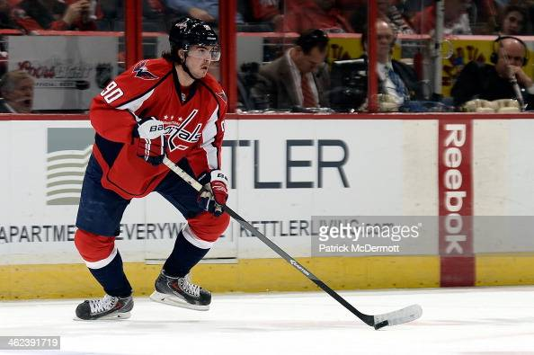 Marcus Johansson of the Washington Capitals controls the puck in the first period during an NHL game against the Toronto Maple Leafs at Verizon...