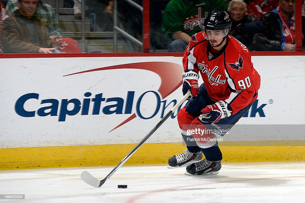 Marcus Johansson of the Washington Capitals controls the puck in the third period during an NHL game against the New Jersey Devils at Verizon Center...