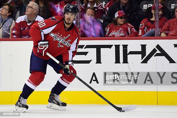 Marcus Johansson of the Washington Capitals controls the puck in the first period against the Carolina Hurricanes during an NHL game at Verizon...