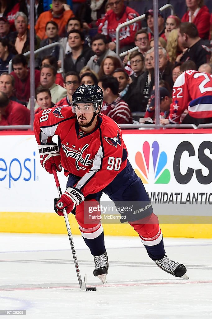 Marcus Johansson of the Washington Capitals controls the puck in the third period against the Calgary Flames during an NHL game at Verizon Center on...