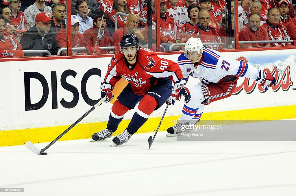 <a gi-track='captionPersonalityLinkClicked' href=/galleries/search?phrase=Marcus+Johansson&family=editorial&specificpeople=4247883 ng-click='$event.stopPropagation()'>Marcus Johansson</a> #90 of the Washington Capitals handles the puck in the third period against <a gi-track='captionPersonalityLinkClicked' href=/galleries/search?phrase=Ryan+McDonagh&family=editorial&specificpeople=4324983 ng-click='$event.stopPropagation()'>Ryan McDonagh</a> #27 of the New York Rangers in Game One of the Eastern Conference Quarterfinals during the 2013 NHL Stanley Cup Playoffs at Verizon Center on May 2, 2013 in Washington, DC.