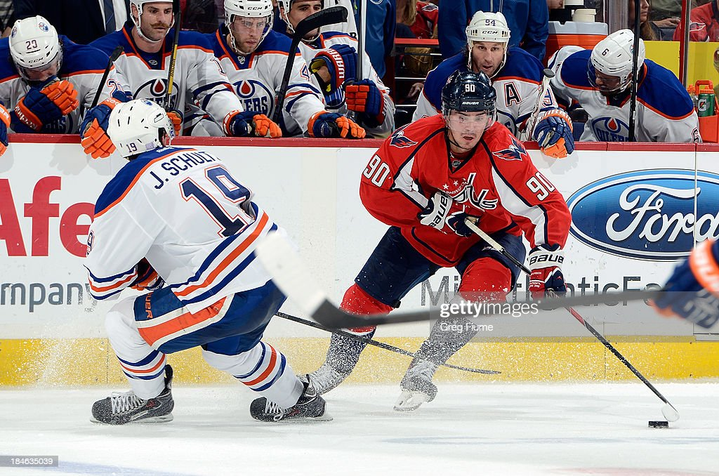 <a gi-track='captionPersonalityLinkClicked' href=/galleries/search?phrase=Marcus+Johansson&family=editorial&specificpeople=4247883 ng-click='$event.stopPropagation()'>Marcus Johansson</a> #90 of the Washington Capitals handles the puck in the third period against <a gi-track='captionPersonalityLinkClicked' href=/galleries/search?phrase=Justin+Schultz&family=editorial&specificpeople=5370958 ng-click='$event.stopPropagation()'>Justin Schultz</a> #19 of the Edmonton Oilers at the Verizon Center on October 14, 2013 in Washington, DC.