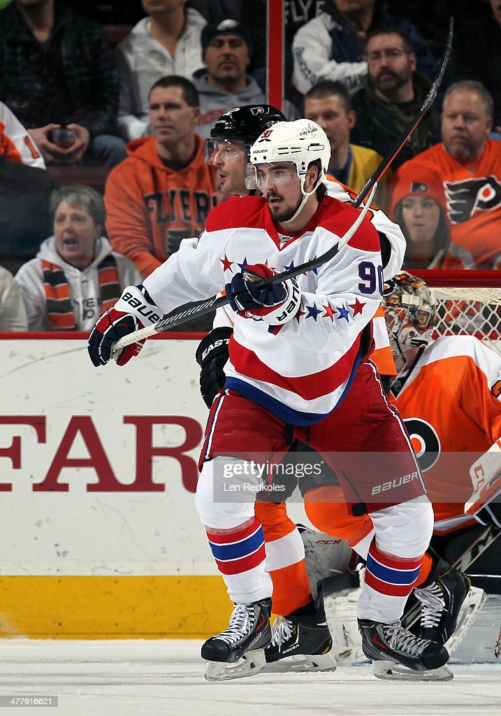 Marcus Johansson #90 of the Washington Capitals in action against Mark Streit #32 and Steve Mason #35 of the Philadelphia Flyers on March 5, 2014 at the Wells Fargo Center in Philadelphia, Pennsylvania.