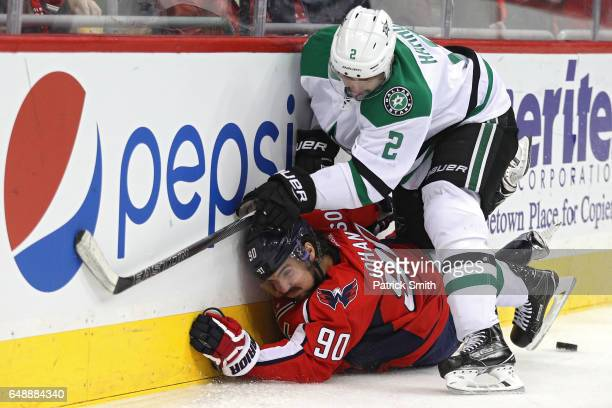Marcus Johansson of the Washington Capitals is checked by Dan Hamhuis of the Dallas Stars during the second period at Verizon Center on March 6 2017...