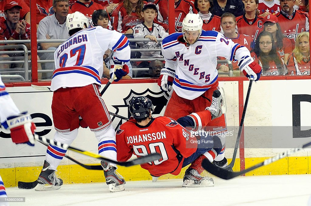 <a gi-track='captionPersonalityLinkClicked' href=/galleries/search?phrase=Marcus+Johansson&family=editorial&specificpeople=4247883 ng-click='$event.stopPropagation()'>Marcus Johansson</a> #90 of the Washington Capitals is knocked to the ice by <a gi-track='captionPersonalityLinkClicked' href=/galleries/search?phrase=Ryan+Callahan&family=editorial&specificpeople=809690 ng-click='$event.stopPropagation()'>Ryan Callahan</a> #24 of the New York Rangers in Game Four of the Eastern Conference Semifinals during the 2012 NHL Stanley Cup Playoffs at the Verizon Center on May 5, 2012 in Washington, DC.