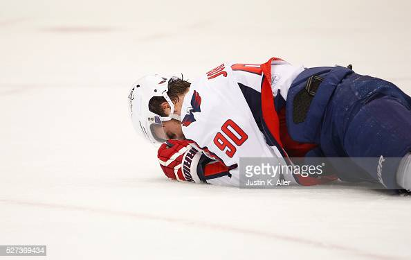 Marcus Johansson of the Washington Capitals lays injured on the ice in the first period against the Pittsburgh Penguins in Game Three of the Eastern...