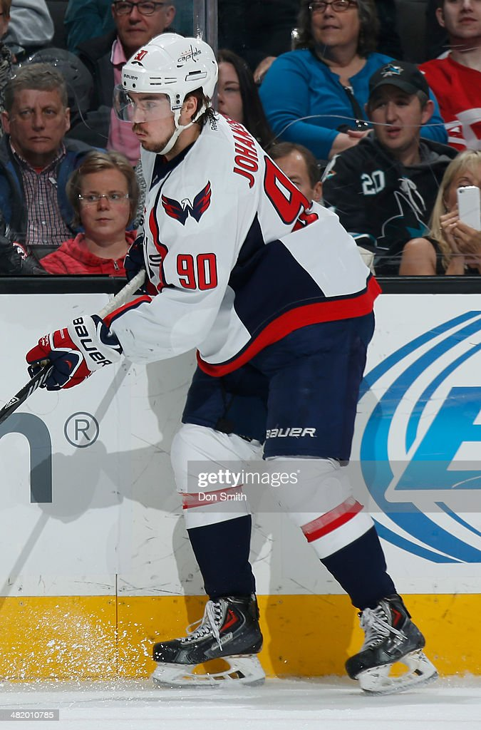Marcus Johansson #90 of the Washington Capitals makes a pass against the San Jose Sharks during an NHL game on March 22, 2014 at SAP Center in San Jose, California.