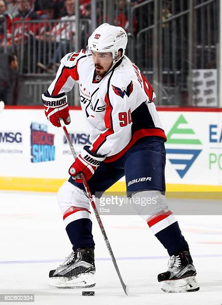 Marcus Johansson of the Washington Capitals passes the puck in the first period against the New Jersey Devilson January 26 2017 at Prudential Center...