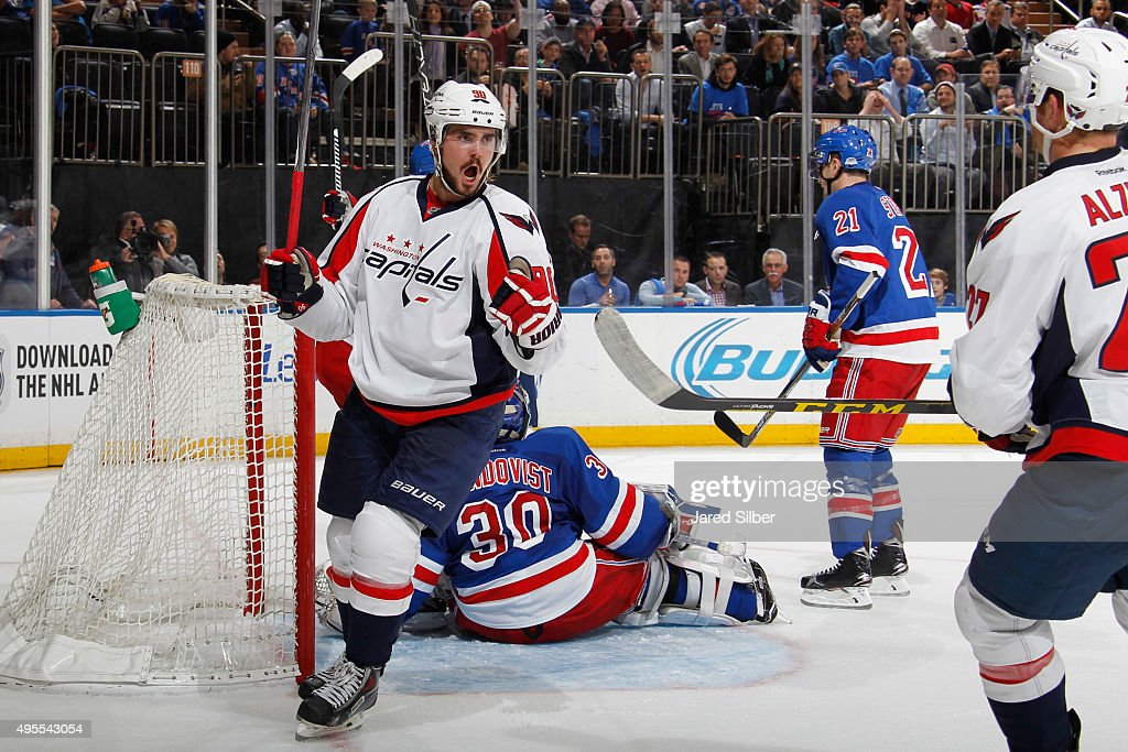Marcus Johansson of the Washington Capitals reacts after scoring a goal in the second period against Henrik Lundqvist of the New York Rangers at...