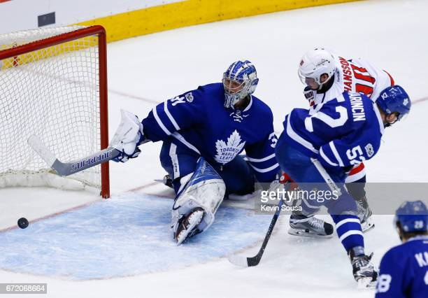 Marcus Johansson of the Washington Capitals scores the game and series winning goal on Frederik Andersen of the Toronto Maple Leafs as Martin...