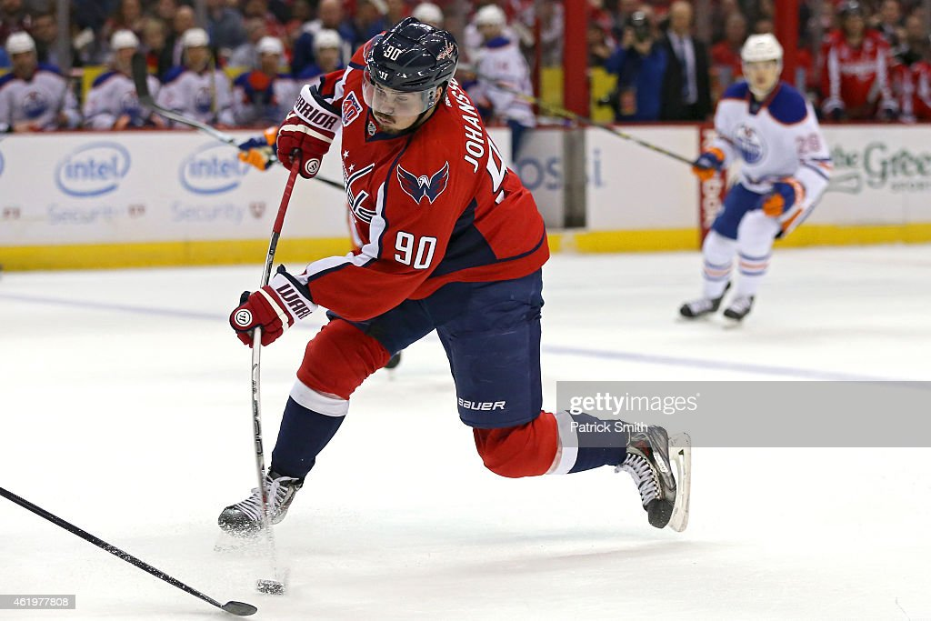 Marcus Johansson of the Washington Capitals shoots the puck against the Edmonton Oilers at Verizon Center on January 20 2015 in Washington DC The...