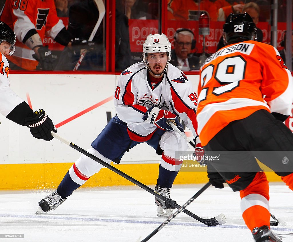 <a gi-track='captionPersonalityLinkClicked' href=/galleries/search?phrase=Marcus+Johansson&family=editorial&specificpeople=4247883 ng-click='$event.stopPropagation()'>Marcus Johansson</a> #90 of the Washington Capitals skates against the Philaselphia Flyers during an NHL hockey game at Wells Fargo Center on March 31, 2013 in Philadelphia, Pennsylvania.