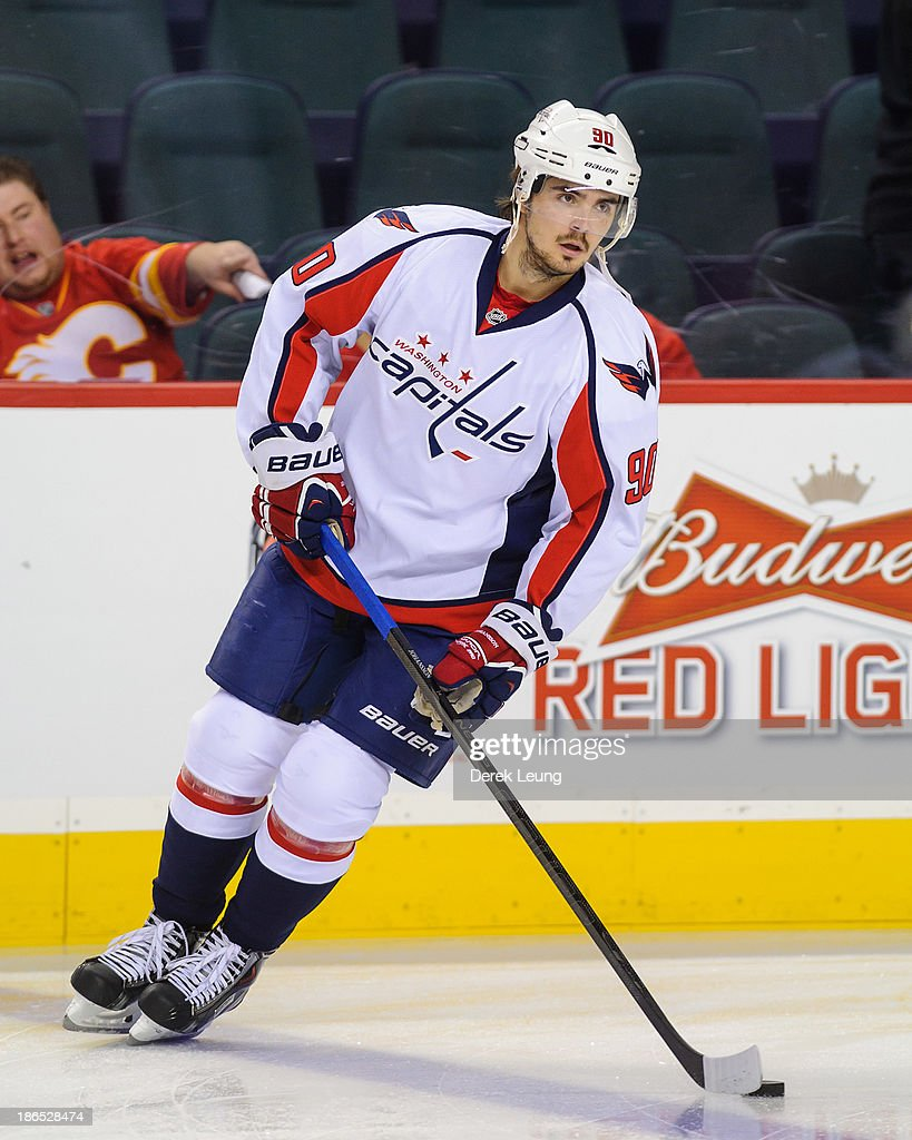 Marcus Johansson #90 of the Washington Capitals skates against the Calgary Flames during an NHL game at Scotiabank Saddledome on October 26, 2013 in Calgary, Alberta, Canada.