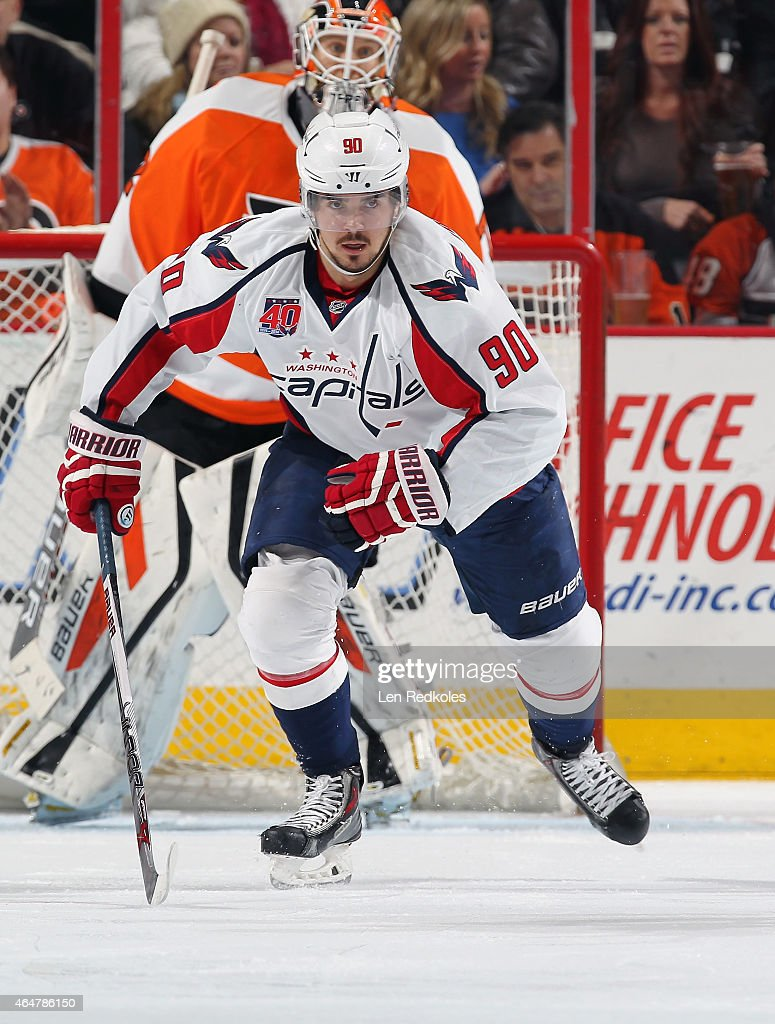 Marcus Johansson of the Washington Capitals skates in front of Rob Zepp of the Philadelphia Flyers on February 22 2015 at the Wells Fargo Center in...