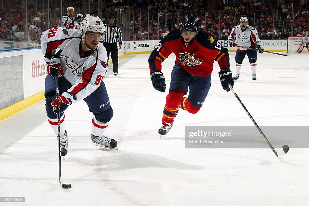 <a gi-track='captionPersonalityLinkClicked' href=/galleries/search?phrase=Marcus+Johansson&family=editorial&specificpeople=4247883 ng-click='$event.stopPropagation()'>Marcus Johansson</a> #90 of the Washington Capitals skates with the puck against <a gi-track='captionPersonalityLinkClicked' href=/galleries/search?phrase=Mike+Santorelli&family=editorial&specificpeople=4517042 ng-click='$event.stopPropagation()'>Mike Santorelli</a> #13 of the Florida Panthers at the BankAtlantic Center on February 17, 2012 in Sunrise, Florida.