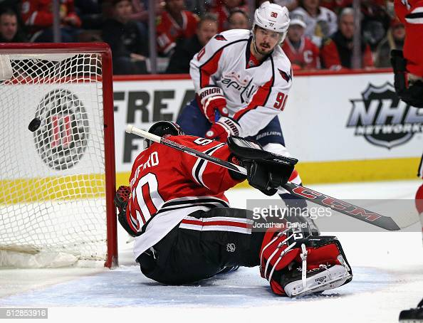 Marcus Johansson of the Washington Capitals slips the puck past Corey Crawford of the Chicago Blackhawks for a first period goal at the United Center...