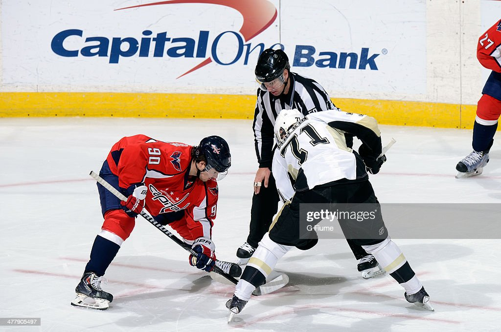 Marcus Johansson #90 of the Washington Capitals takes a face-off against Evgeni Malkin #71 of the Pittsburgh Penguins at the Verizon Center on March 10, 2014 in Washington, DC.