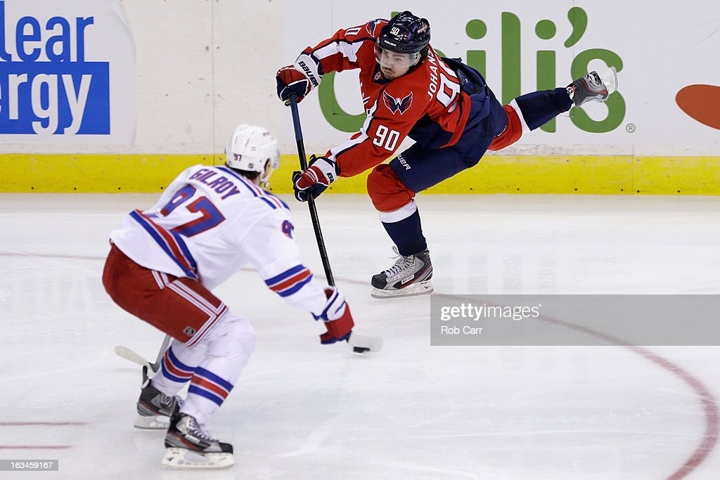<a gi-track='captionPersonalityLinkClicked' href=/galleries/search?phrase=Marcus+Johansson&family=editorial&specificpeople=4247883 ng-click='$event.stopPropagation()'>Marcus Johansson</a> #90 of the Washington Capitals takes a shot on goal against <a gi-track='captionPersonalityLinkClicked' href=/galleries/search?phrase=Matt+Gilroy&family=editorial&specificpeople=817917 ng-click='$event.stopPropagation()'>Matt Gilroy</a> #97 of the New York Rangers during the third period at Verizon Center on March 10, 2013 in Washington, DC.