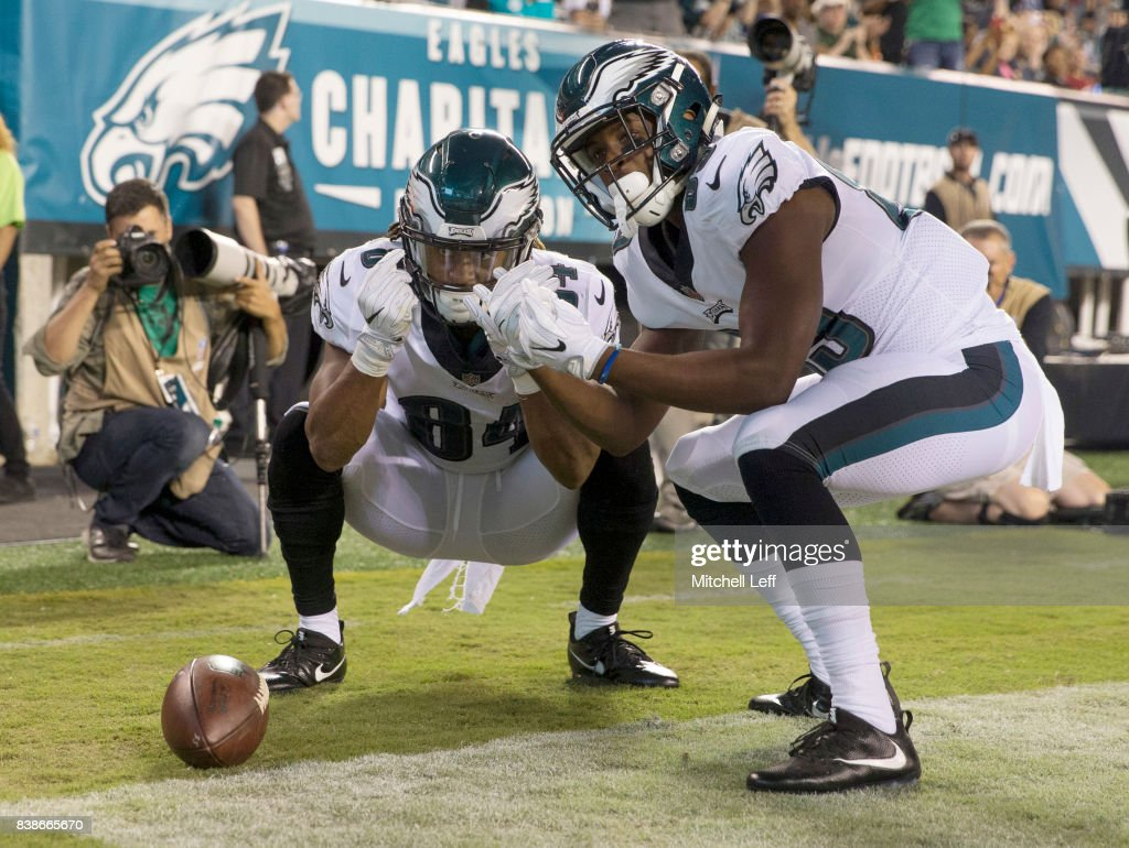 Marcus Johnson #84 and Greg Ward Jr. #89 of the Philadelphia Eagles celebrate after a touchdown by Johnson in the fourth quarter against the Miami Dolphins in the preseason game at Lincoln Financial Field on August 24, 2017 in Philadelphia, Pennsylvania. The Eagles defeated the Dolphins 38-31.