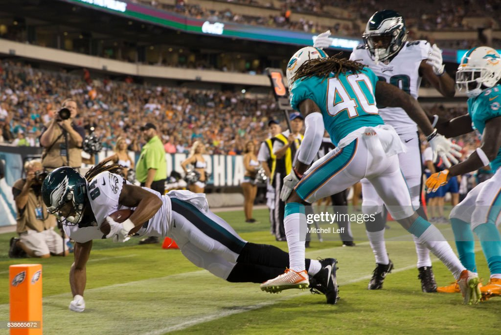 Marcus Johnson #84 of the Philadelphia Eagles catches a touchdown against Lafayette Pitts #40 of the Miami Dolphins in the fourth quarter in the preseason game at Lincoln Financial Field on August 24, 2017 in Philadelphia, Pennsylvania. The Eagles defeated the Dolphins 38-31.