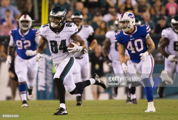 Marcus Johnson of the Philadelphia Eagles runs with the ball against Tanner Vallejo of the Buffalo Bills the preseason game at Lincoln Financial...