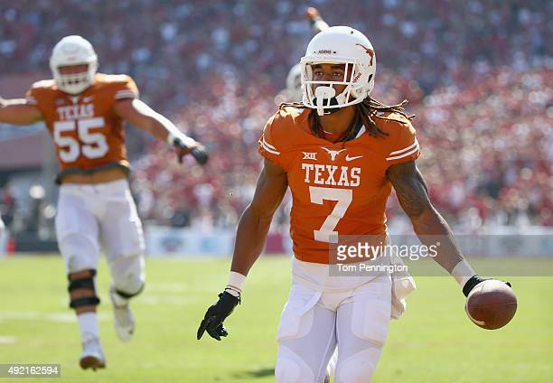 Marcus Johnson of the Texas Longhorns celebrates after scoring a touchdown against the Oklahoma Sooners in the first quarter during the ATT Red River...