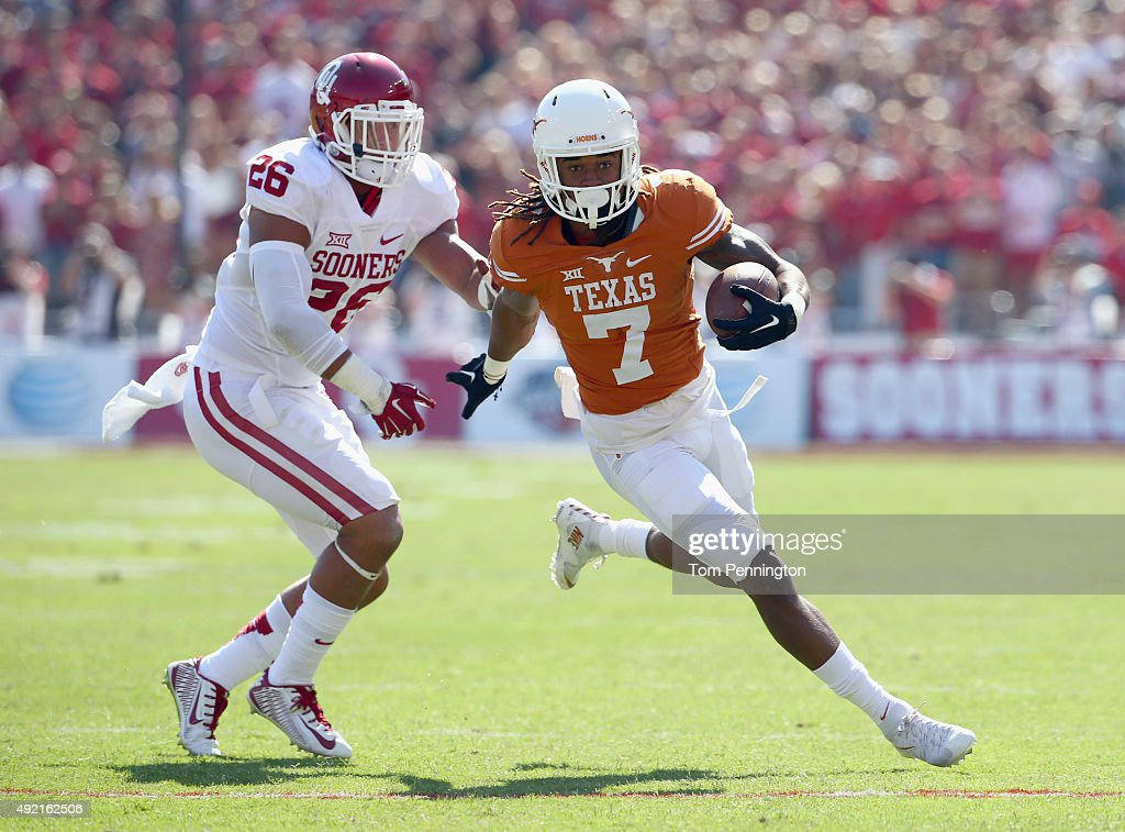 Marcus Johnson of the Texas Longhorns scores a touchdown against Jordan Evans of the Oklahoma Sooners in the first quarter during the ATT Red River...