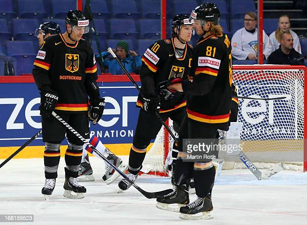 Marcus Kink Christian Ehrhoff and Torsten Ankert of Germany look dejected during the IIHF World Championship group H match between Germany and...