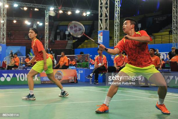 Marcus Kong and Maggie Chan of Australia compete against Carlos Henrriquez and Camila Navas of El Salvador during Mixed Double qualification round of...