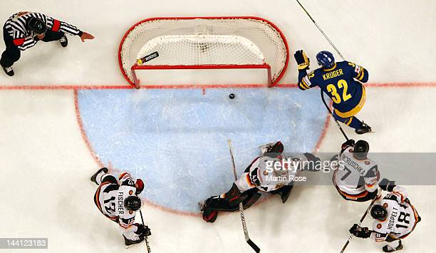 Marcus Krueger of Sweden scores his team's 1st goal during the IIHF World Championship group S match between Sweden and Germany at Ericsson Globe on...