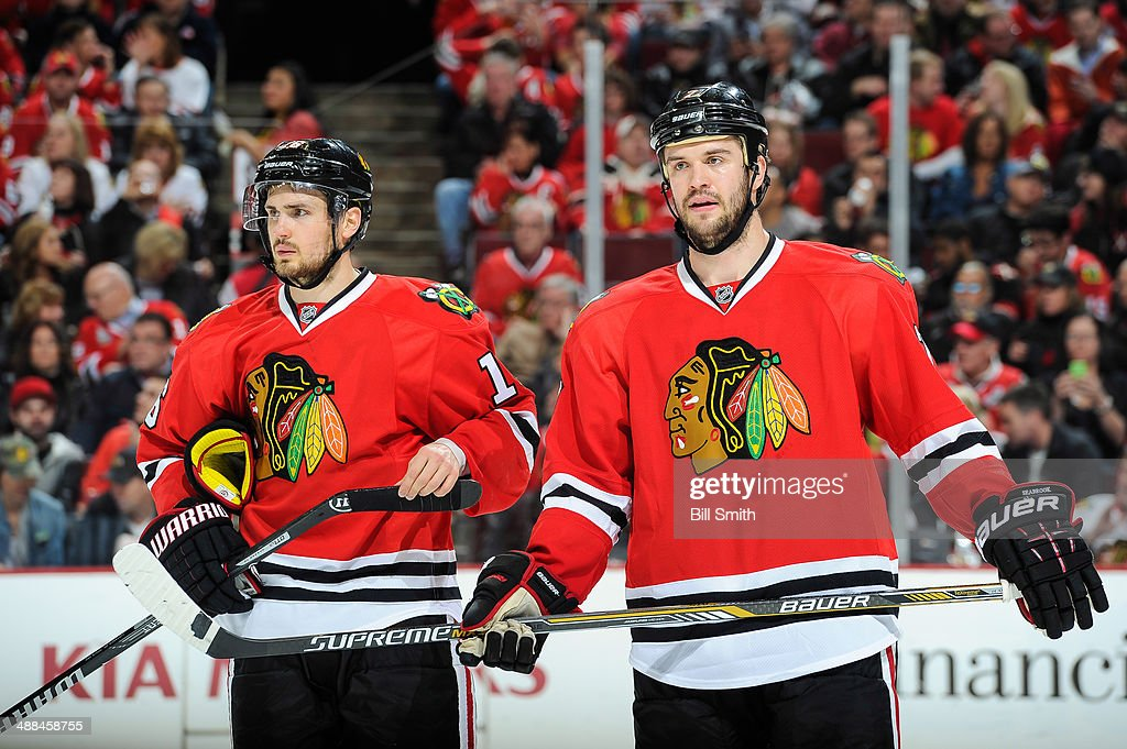 Marcus Kruger #16 and <a gi-track='captionPersonalityLinkClicked' href=/galleries/search?phrase=Brent+Seabrook&family=editorial&specificpeople=638862 ng-click='$event.stopPropagation()'>Brent Seabrook</a> #7 of the Chicago Blackhawks wait for play to begin in Game One of the Second Round of the 2014 Stanley Cup Playoffs against the Minnesota Wild at the United Center on May 2, 2014 in Chicago, Illinois.