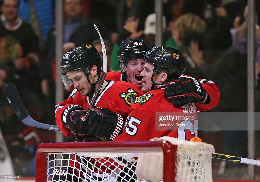 Marcus Kruger #16, Joakim Nordstrom #42 and <a gi-track='captionPersonalityLinkClicked' href=/galleries/search?phrase=Andrew+Shaw+-+Eishockeyspieler&family=editorial&specificpeople=10568695 ng-click='$event.stopPropagation()'>Andrew Shaw</a> #65 of the Chicago Blackhawks celebrate Kruger's second period goal against the Carolina Hurricanes at the United Center on March 2, 2015 in Chicago, Illinois.