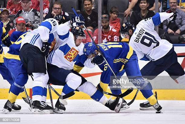 Marcus Kruger of Team Sweden battles for a loose puck with Leo Komarov of Team Finland during the World Cup of Hockey 2016 at Air Canada Centre on...