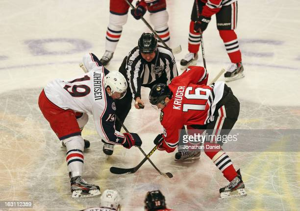 Marcus Kruger of the Chicago Blackhawks and Ryan Johansen of the Columbus Blue Jackets wait for a faceoff at the United Center on March 1 2013 in...